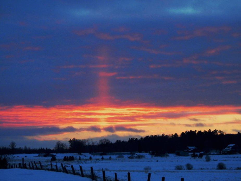 It was -22 degrees Celsius when I took this picture of the sunset. The pink sky showing going up ...