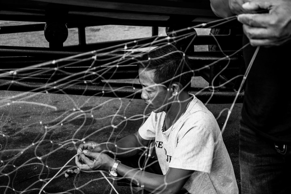 Till this century we still find fishermen fixing the nets before the next day's catch.