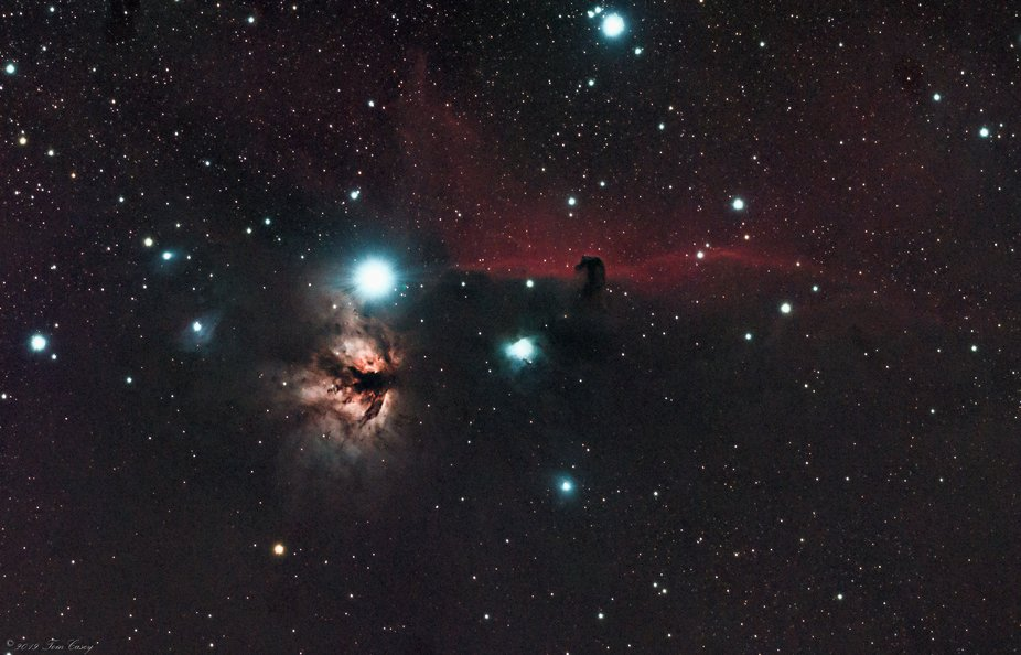 The Horsehead Nebula (NGC 2023) and the Flame Nebula (NGC 2024) in the constellation Orion, both ...