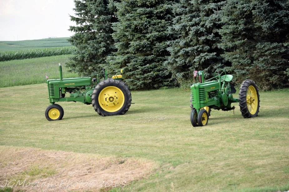 Two of the son-in-law's old John Deere tractors, restored.