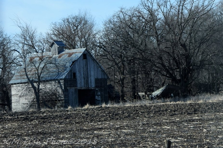 Abandoned farm place in rural Iowa.  House has already fallen.  Barn is still standing, but for how long?