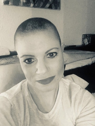 Woman with shaved head in black & white