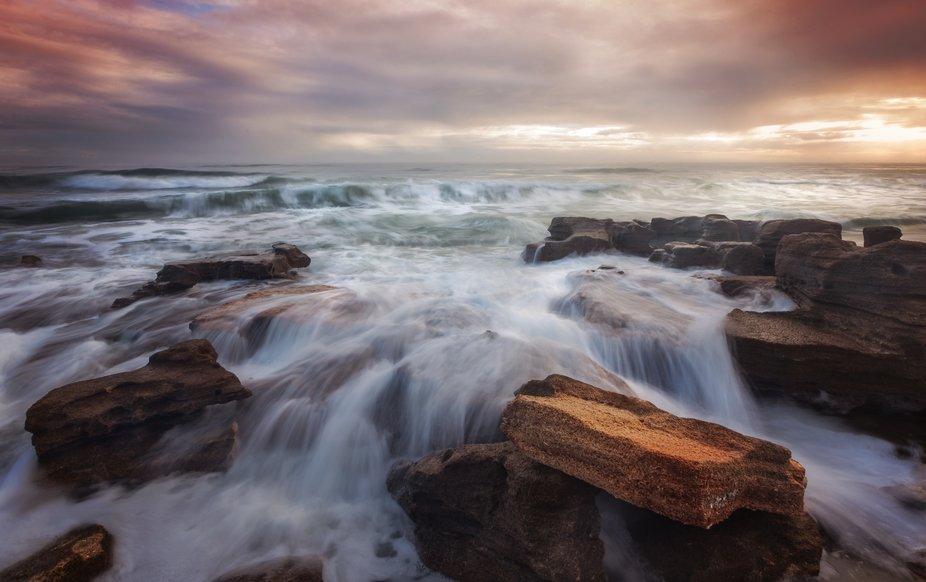 Waves cascade over the coquina rocks on a Florida mid-Atlantic beach.