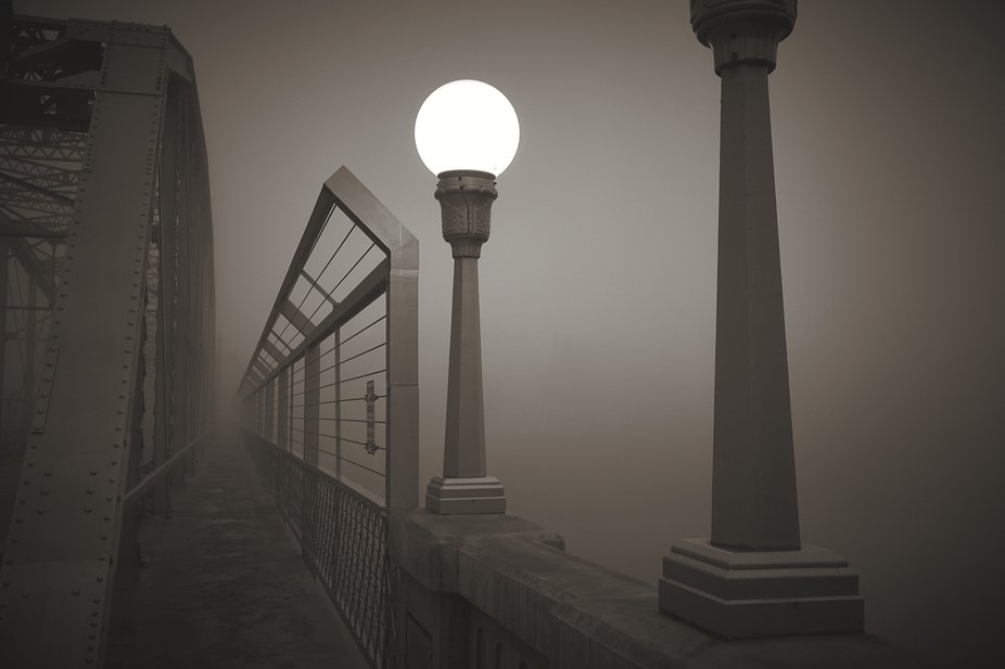 Thick fog engulfs the Veterans Memorial Bridge at Healdsburg, California.