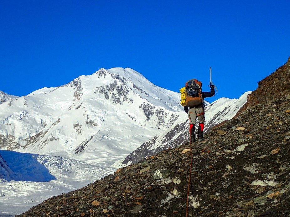 Traversing the edge of a glacier in the Alaska Range on an incredibly clear day near Denali
