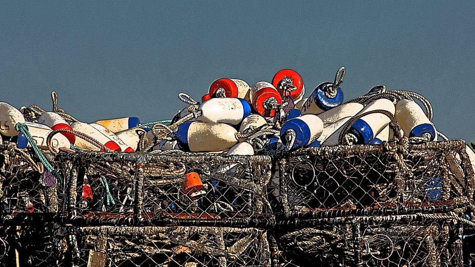 Crab pots stacked on the shore at the Westport, Washington marina
