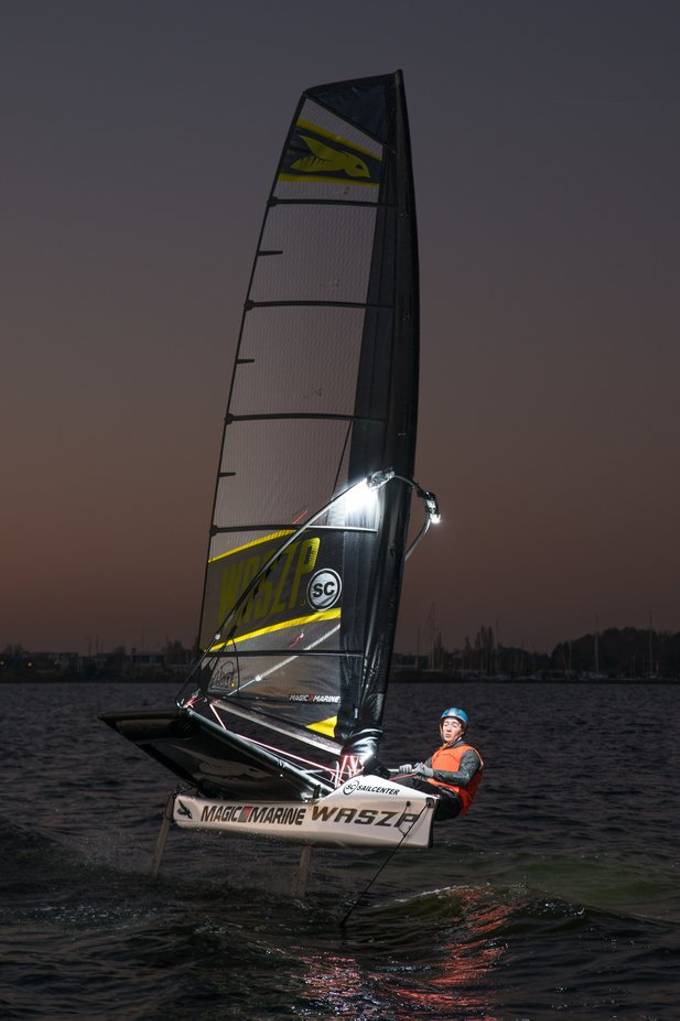 WASZP night-sailing with Elliott Savelon on the Brasseemermeer, Netherlands. Four compact flashes (Godox TT600) were sealed and taped to the hydrofoil sailboat WASZP.