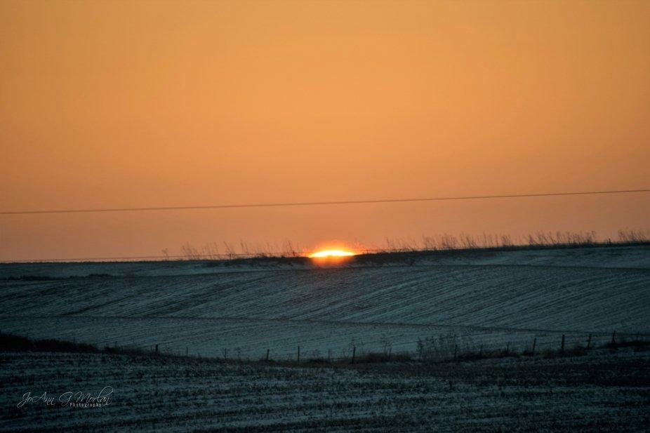 Weekend sunset over empty fields.