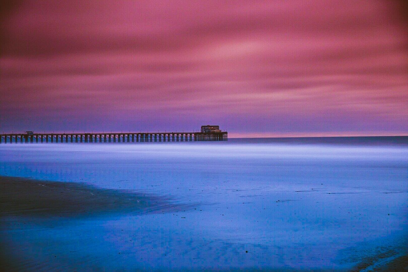 Taken after sunset using a 10 stop ND filter for a long exposure. Looking at Oceanside pier the waves are just a white mist.