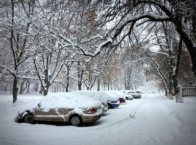 Winter morning. The street of the city is covered with night snow. Ukraine.