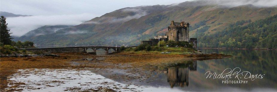 A panarama shot of Eilean Donan Castle, taken in September 2018, on Loch Duich in the Western Hig...