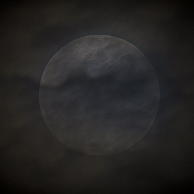 Full moon peaking through the clouds