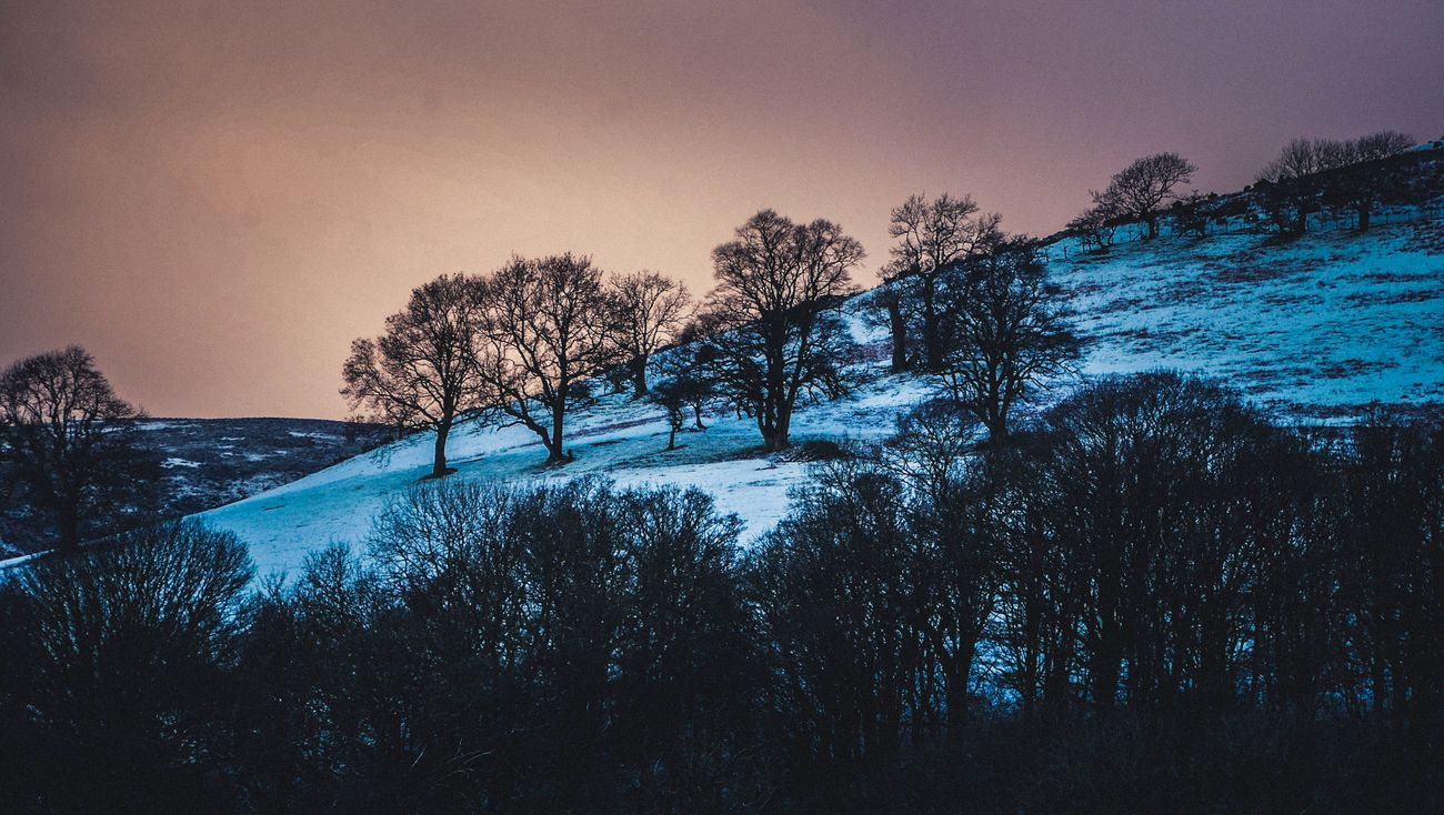 Full moon and sprinkle of snow on the Shropshire Hills.