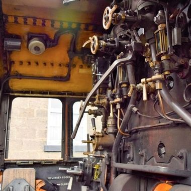 A view of the engine room operating valves of a steam train, at rest in Grosmont village.