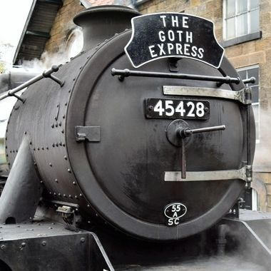 This steam train is decorated with the Goth Express plaque when the Goth festival is on at Whitby.