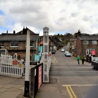 The road crossing the railway lines leaves Grosmont village up a steep incline to the main road.