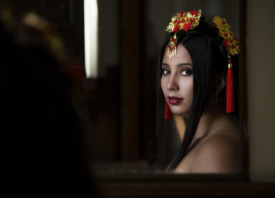 Using natural light from the window I caught the reflection of my model in an old mirror that han...