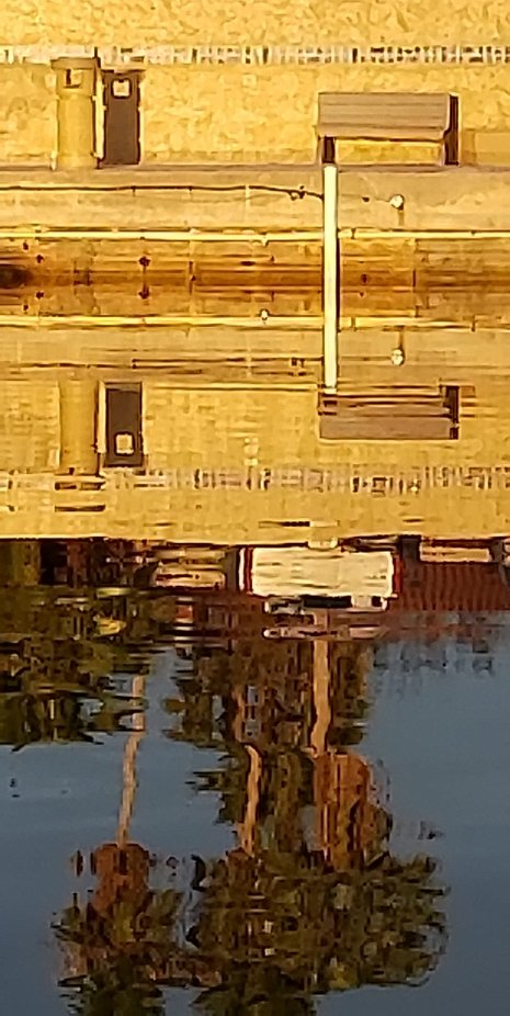 This image was shot on a calm water day with the bench as the subject in the reflection.