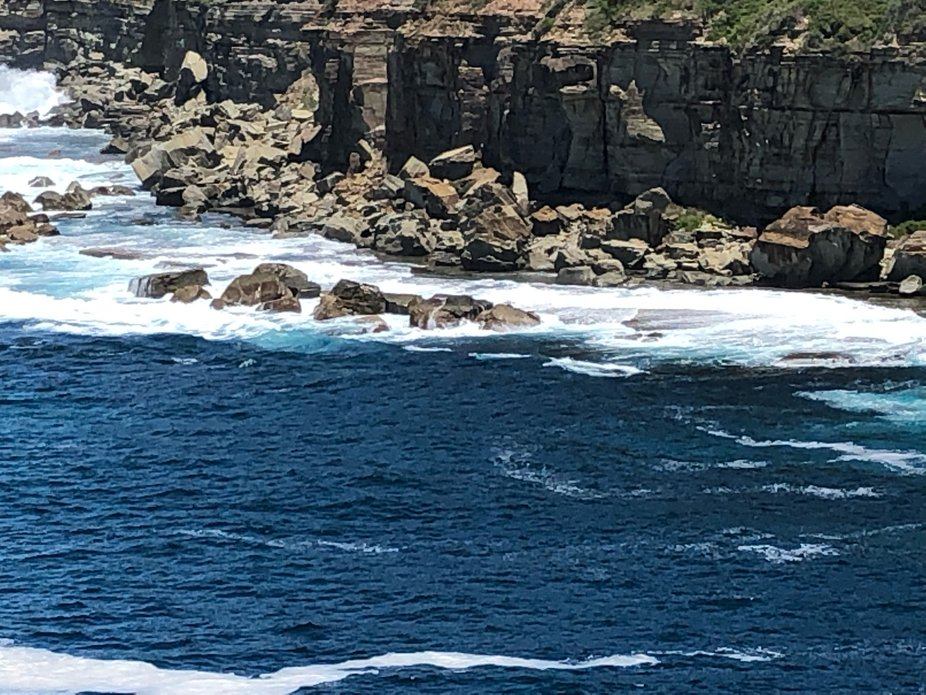 Close up photo of the view of the cliffs from the Skillion in Terrigal, NSW, Australia
