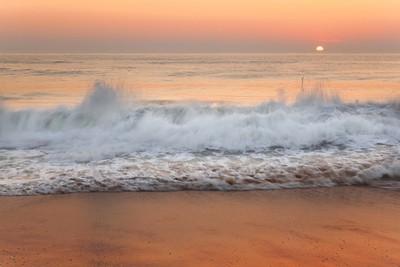 Crashing Tide during sunrise Salisbury Beach Mass