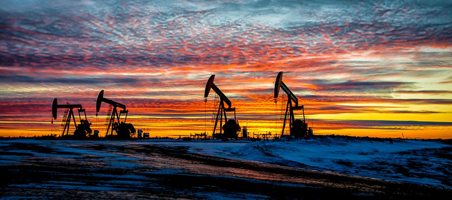 The sun sets on another day.  Pumpjacks silhouetted.