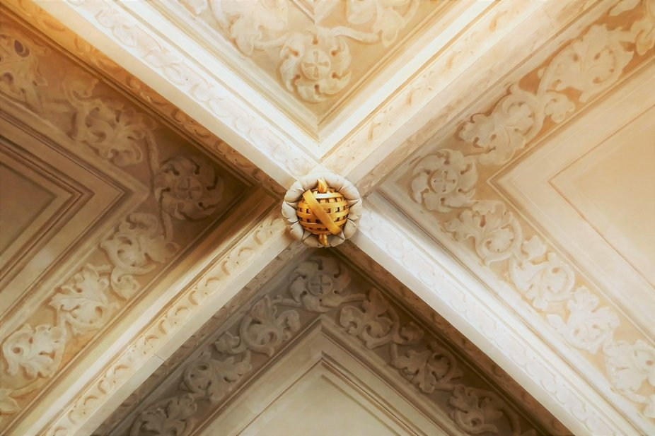 In a palace where each ceiling is entirely different, the detailing on this was elegant and simpl...