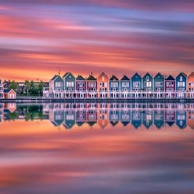 This image was taken in Houten. A small city in the Netherlands. I love these colorful house and I created a super long exposure to enhance the b...