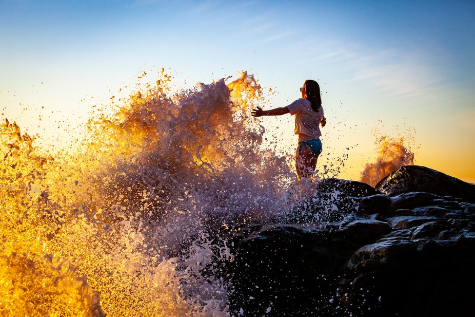Mia orchestrating the waves at sunset near Point Mugu Rock.