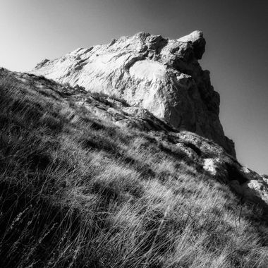 Diagonal view of large rock in black and white