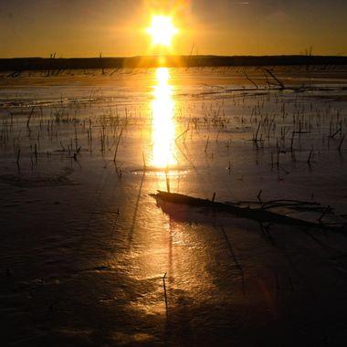 Frozen sunset lake
