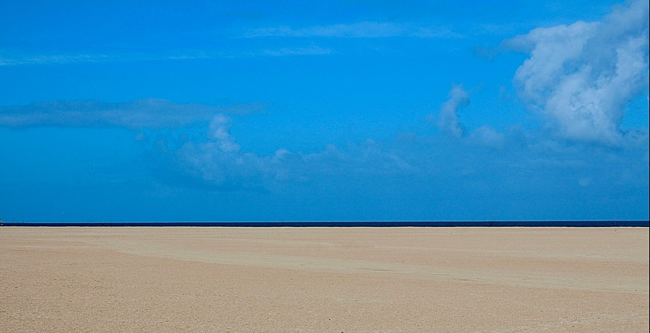 Taken on a visit to Normandy, France, the beach stretches 8 kilometres (5.0 mi) from Ouistreham t...