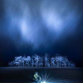 Sitting on a frozen lake on a frosty night in Joensuu, Finland.