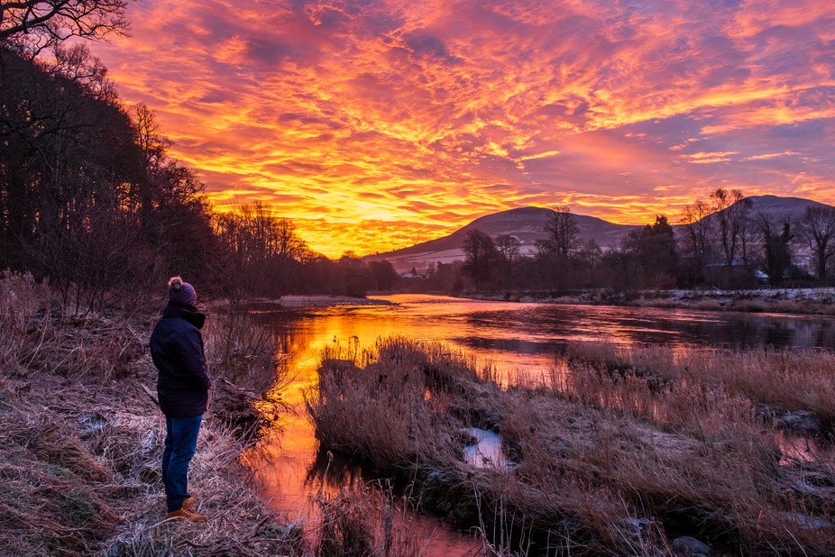 Reflect on this beautiful sunrise with a selfie while looking deep into the stunning morning in t...