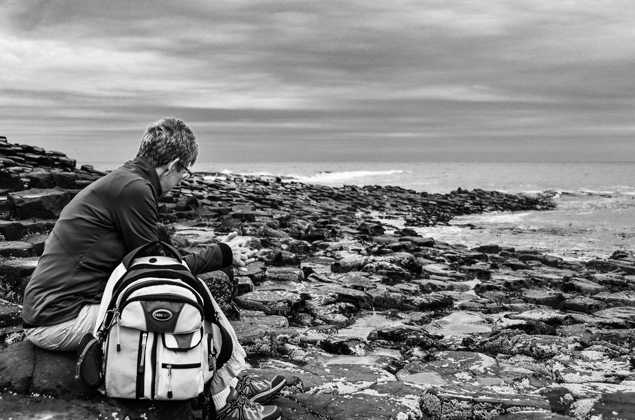My mom, contemplating life on the Giant's Causeway, County Antrim, Northern Ireland, UK