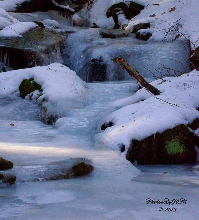 Taken with Nikon D5100 using AF-S Nikkor 70-300mm 1:4.5-5.6 G lens. I was experimenting with Aperture Priority mode. I have another shot of this stream in my gallery that was taken in spring with the water flowing.