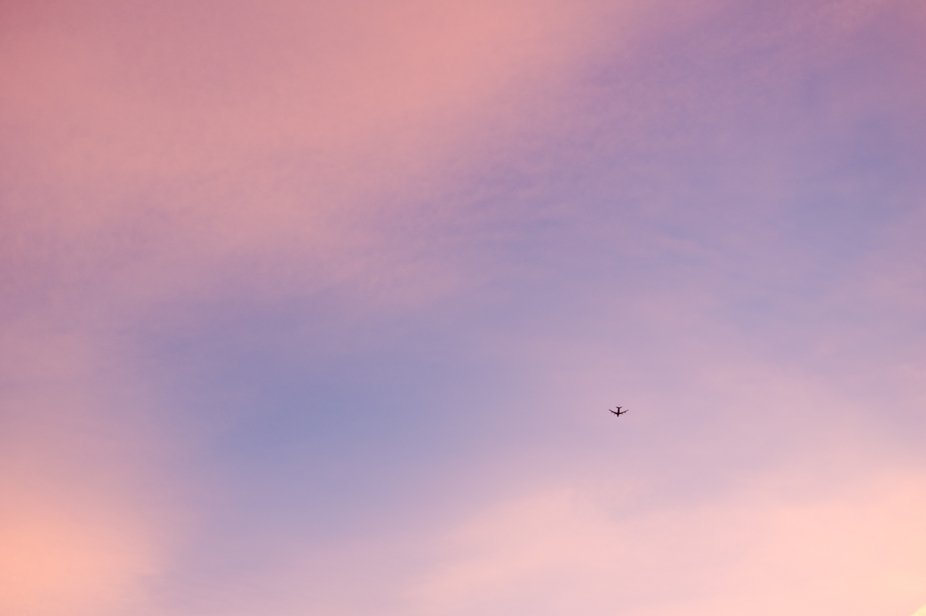 airplane on a beautifully colored sunset sky