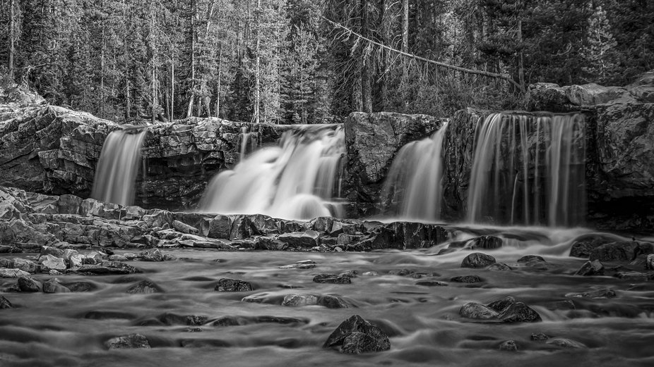 Located about a half mile upstream from the Upper Provo River Falls in the Uintah National Forest...
