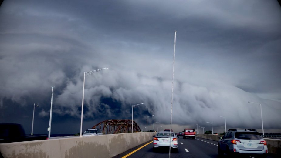 Driving home on Rt 16 South at Dover point. I loved how the cloud mirrored the rusty bridge.  . I...