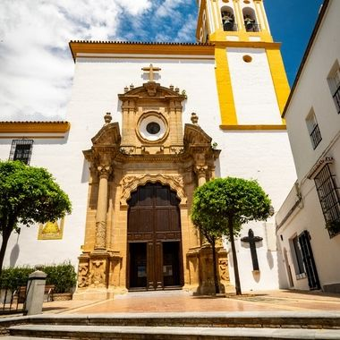 a beautiful summer photo of the Iglesia Mayor de la Encarnacion which is the main church hidden in the old town of Marbella center, Spain.