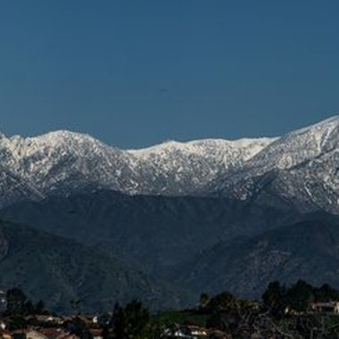 Mt. Baldy (a.k.a Mount San Antonio) is 36 miles east of Los Angeles downtown . The elevation of the highest peak is at 10,064 ft.  I have been driving home for 40+ years looking at this mountain during winters and wanted to photograph the snow capped peak the way we see it from the freeways.  Finding a good spot to set up for a quality shot is another matter...  Eight high resolution shots (Canon 300 mm, f/2.8 lens) were stitched together for this photo.  The file size of the original stitched photo is more than 70 MB (Viewbug has a 30 MB limit for posting) and I had to save it in much lower resolution for this postast