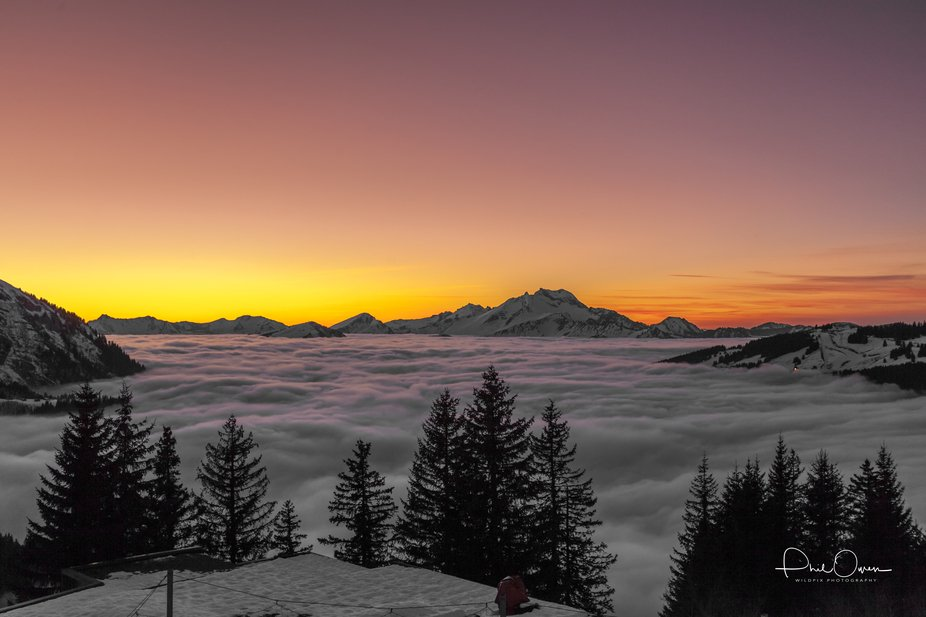 Sunset on top of the clouds