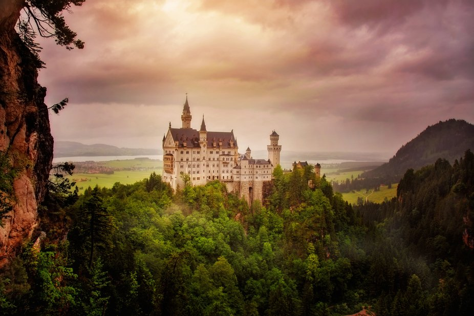 The inspiration for Disney's Cinderella Castle, Neuschwanstein Castle rises above the vi...
