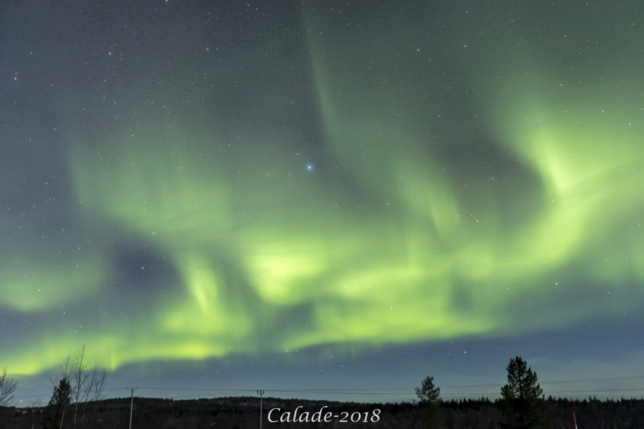 Sky in enlighted over the horizon as aurora fully deploys