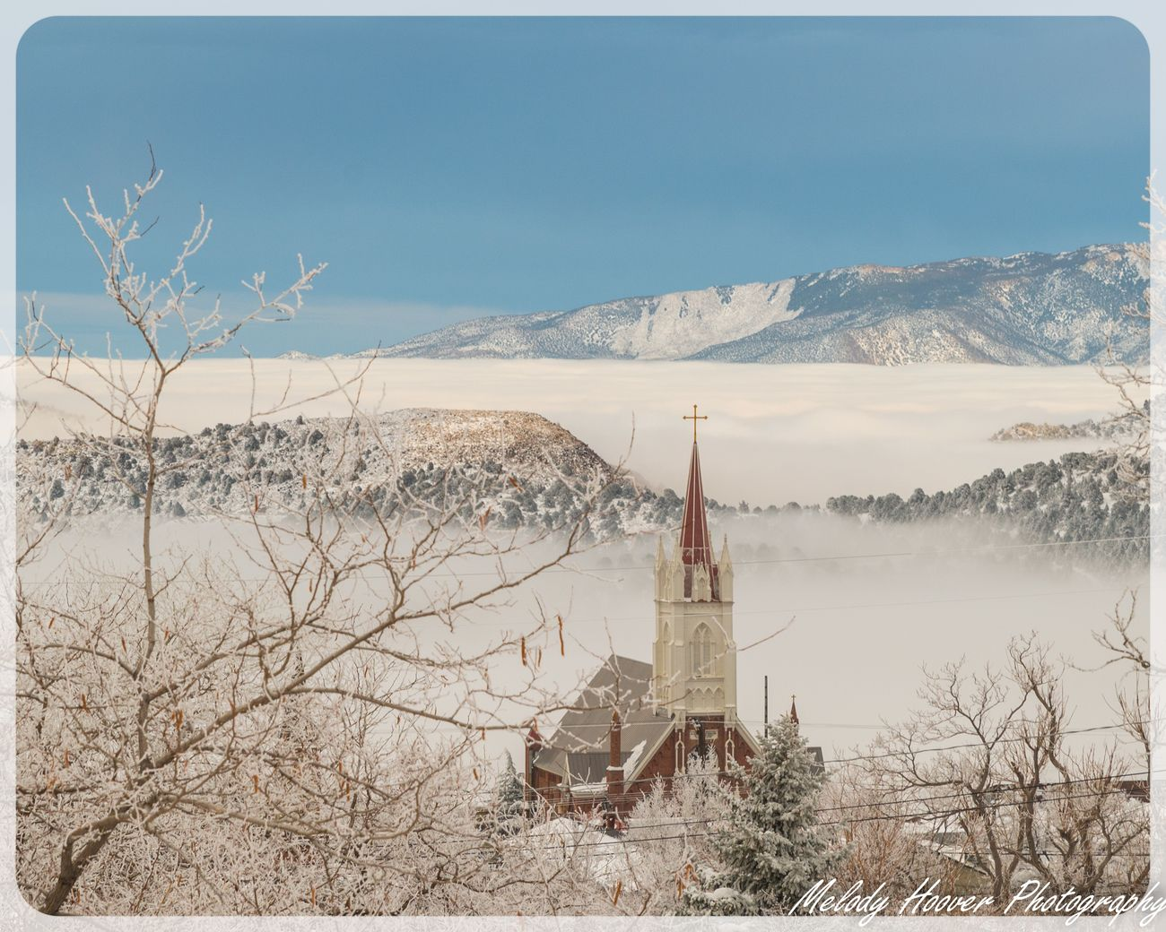 Saint Mary's in the Mountains set in clouds and snow. Historic Virginia City, NV