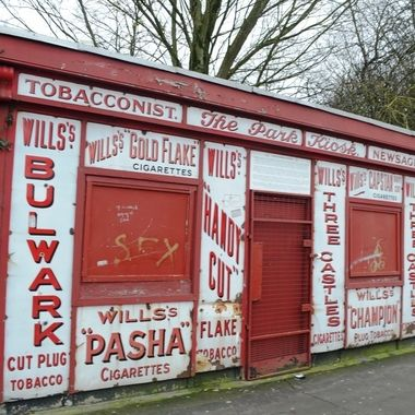 This landmark kiosk is in the Peoples Park in Limerick, Ireland.  It sold ice creams, newspapers, and obviously tobacco.