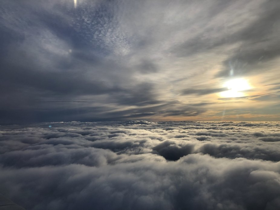 The breathtaking pre-sunset view over the clouds when flying from Lithuania back to Switzerland