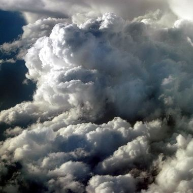 Taking a puddle jumper to Anvil Alaska I saw this cloud cluster. Can you find the lady in it?