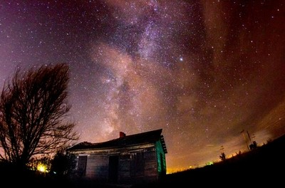 An old abandoned cabin under the milkyway