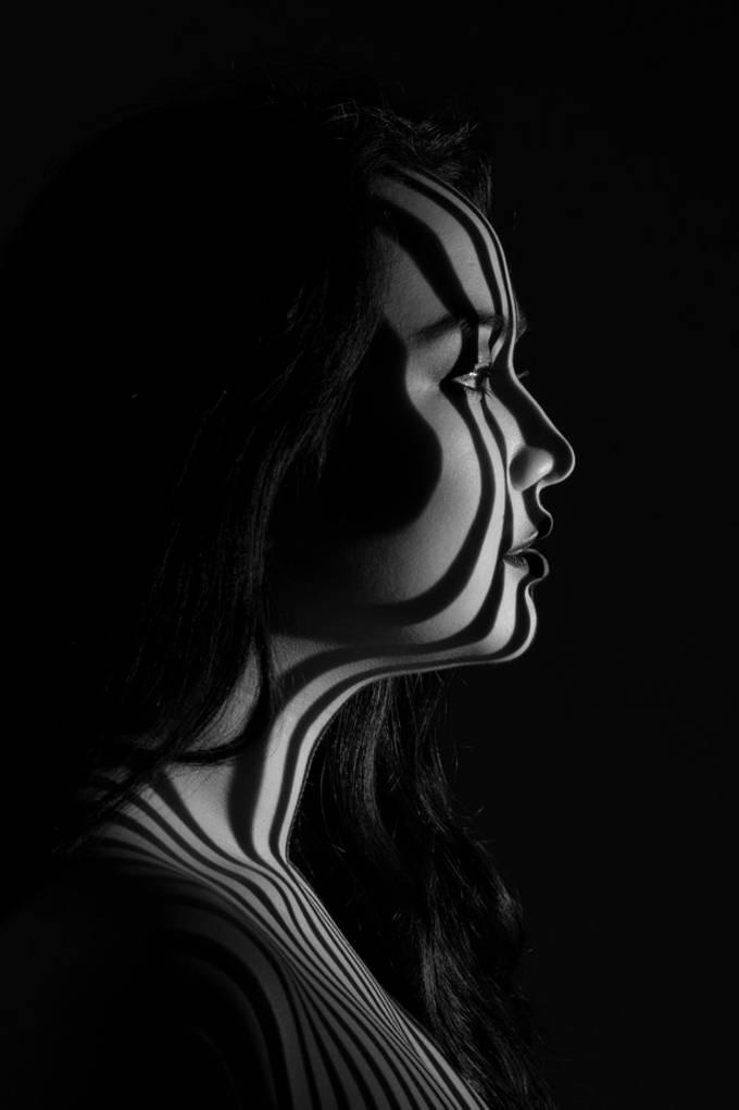 Projection with a Lightblaster, using a metal gobo.  Model: Sandy Huisman, @portfoliosandy 20190211 456