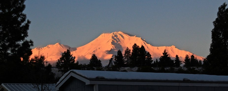 Mount Shasta at sunset, rising above the rooftops of my neighborhood.